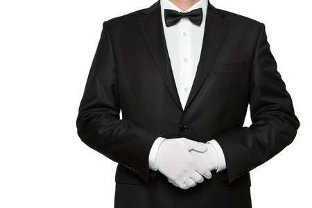 Waiter or well dressed man waiting for orders isolated on white background with copy space photo