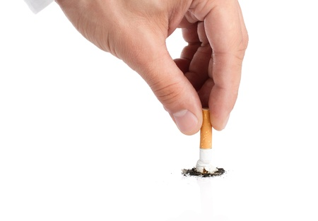 smoking: Quit smoking, close up of male hand puting out cigarette isolated on white background
