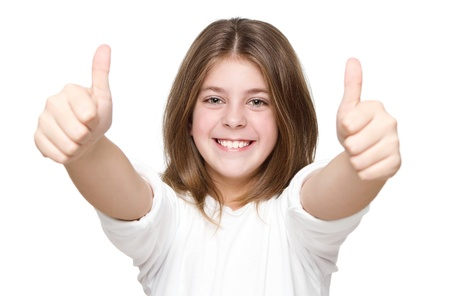 Little girl showing two thumbs up isolated on white background photo