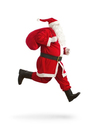 claus: Santa Claus on the run to delivery christmas gifts isolated on white background Stock Photo