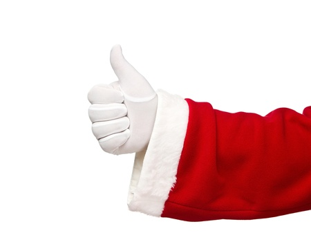 Santa Claus hand showing thumbs up isolated on white background photo