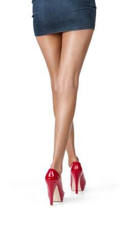 Close-up van elegante vrouwelijke weg te lopen op een witte achtergrond Stockfoto