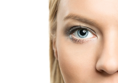 eye exam: Close up of beautiful female face isolated on white background with copy space