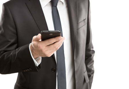 Close up of young businessman using smart phone isolated on white background Stock Photo