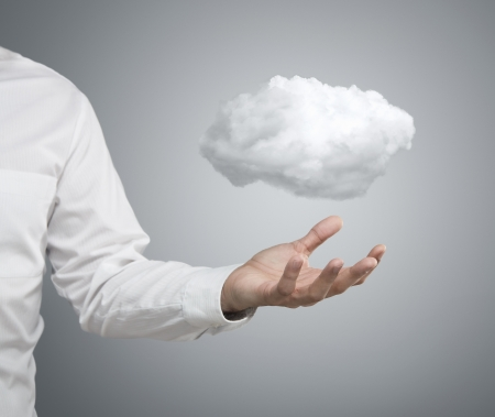 Cloud computing concept, close up of young businessman with cloud over his hand Stock Photo