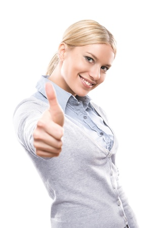 Happy attractive young woman showing thumbs up isolated on white background photo
