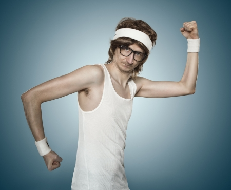 Funny retro sports nerd flexing his muscle over blue background