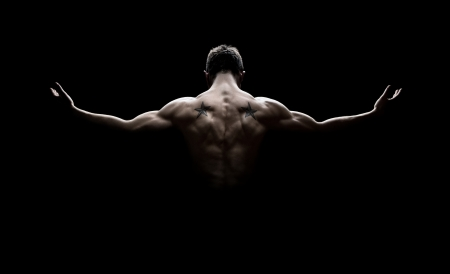 arm muscles: Close Up Of Young Sports Man isolated on black background