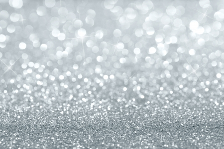 Abstract silver defocused glitter background with copy space photo
