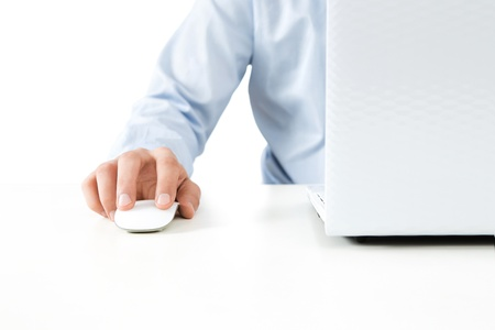 using computer: Close up of young businessman working on a laptop isolated on white background with copy space Stock Photo