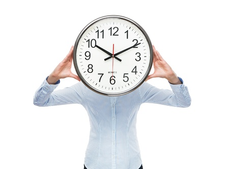 Deadline concept, close up of young businesswoman covering her face with analog clock isolated on white background Stock Photo