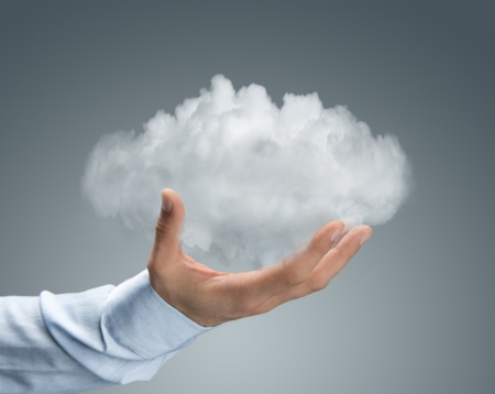 Cloud computing, close up of male hand holding cloud with copy space Stock Photo - 18630642