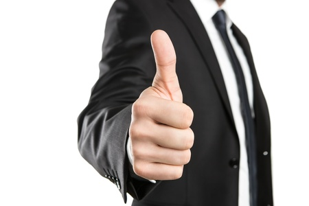 thumbs up gesture: Close up of young businessman showing thumbs up isolated on white background