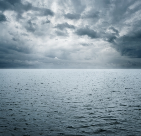 Dramatic scene of ocean befre storm with copy space