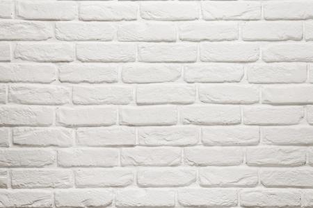 Struttura del muro di mattoni bianchi vuoto, fondo con copia spazio Archivio Fotografico