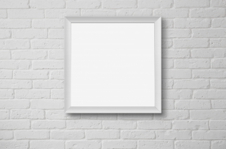Blank picture frame at the white brick wall with copy space and clipping path