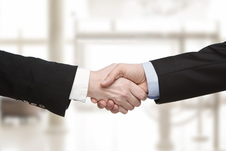 negotiation business: Close up of business handshake