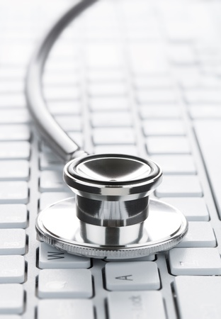 health service: Close up of stethoscope on the computer keyboard with copy space