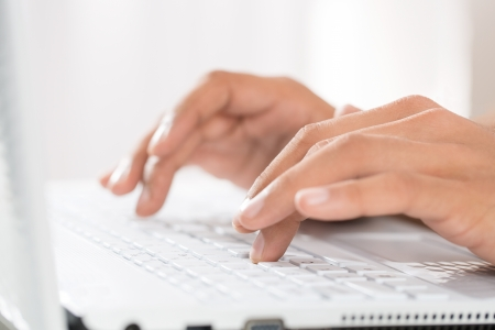 e work: Close up of male hands typing on a laptop Stock Photo