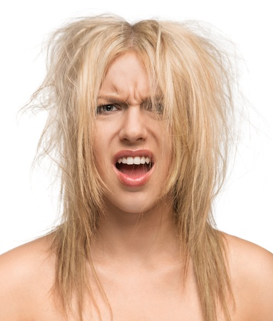 angry blonde: Bad hair day, portrait of a beautiful girl with messed up hair isolated on white background