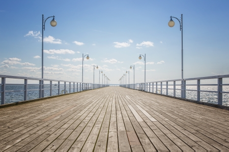 Old empty wooden pier over the sea shore with copy space Stock Photo - 21383865