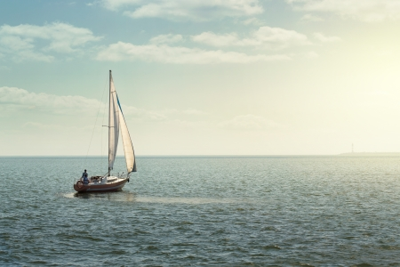 sailboat race: Sailing boat at the open sea with copy space