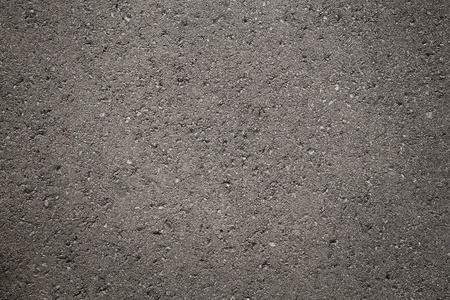 Close up of dark, grunge asphalt, concrete texture with copy space photo