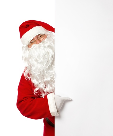christmas costume: Santa Claus pointing on a blank banner isolated on white background