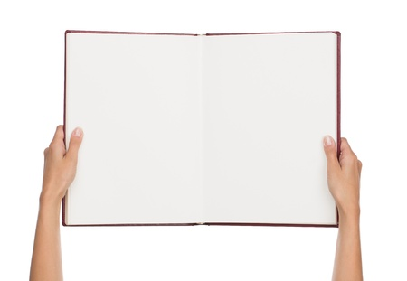 Close up of female hands holding blank book isolated on white background with copy space photo