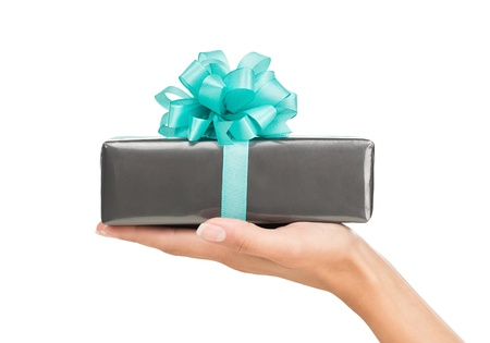 Close up of female hand holding gift box isolated on whie background