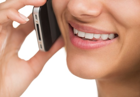Close up of young attractive woman talking on the smart phone photo