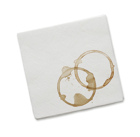 Paper napkin with coffee stains isolated on white background