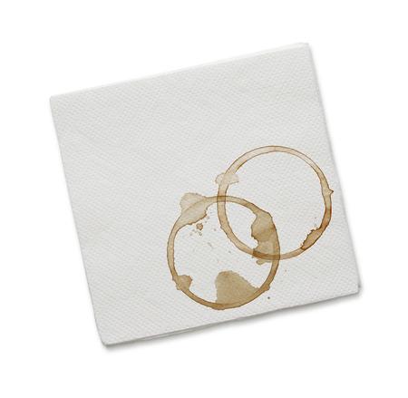 Papieren servet met koffie vlekken op een witte achtergrond Stockfoto