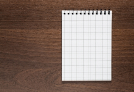 notebook page: Blank notepad at wooden desk with copy space