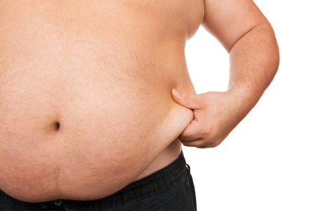 big belly: Fat man checking out his weight isolated on white background