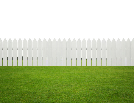 picket fence: Front or back yard, white wooden fence on the grass isolated on white background with copy space