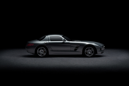 black car: Side View Of Luxury Sports Car Over Black With Copy Space