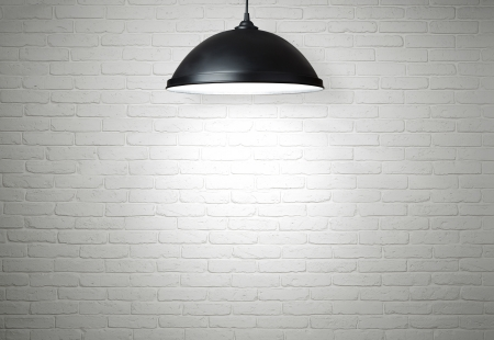 ceiling texture: White brick wall illuminated by the lamp with copy space Stock Photo
