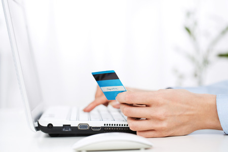 buy online: Close up of young woman using credit card Stock Photo