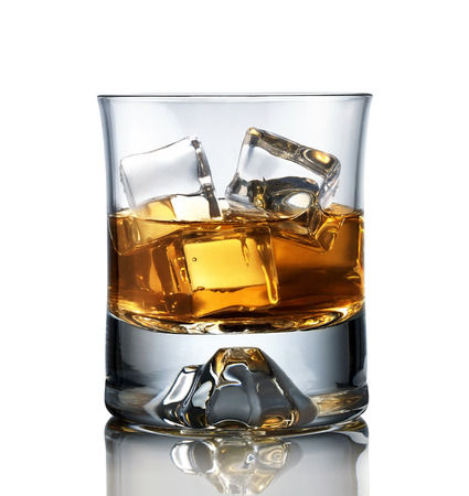 Close up of glass of whiskey isolated on white background photo