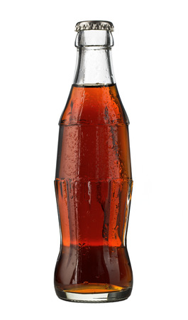 Close up of cola bottle isolated on white