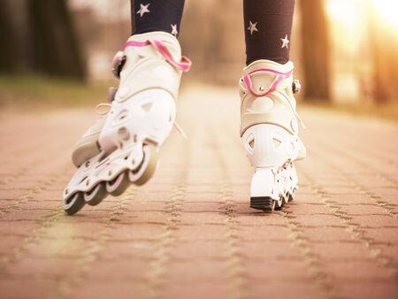 rollerskating: Close up of little girl roller skating in the park