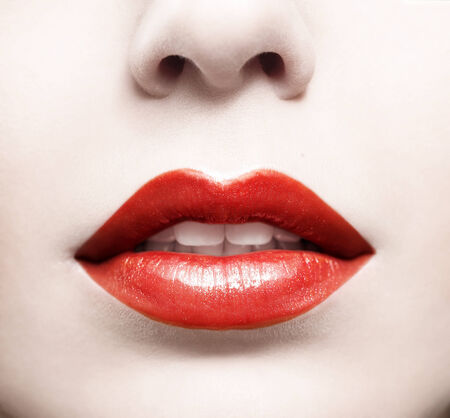 Close up of red glossy female lips photo