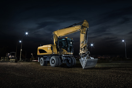 mining truck: Road construction, close up of excavator at night