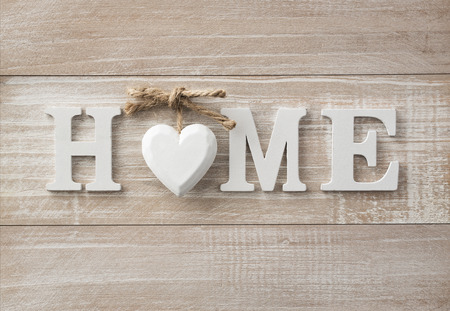 Home sweet home, wooden text on vintage board background with copy space