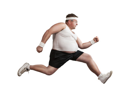 Funny overweight man speeding isolated on white background Foto de archivo
