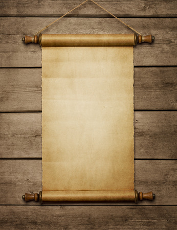 Old grunge blank paper scroll on the wooden wall with copy space Archivio Fotografico