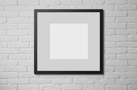 brick sign: Blank picture frame at the brick wall with copy space and clipping path for the inside Stock Photo