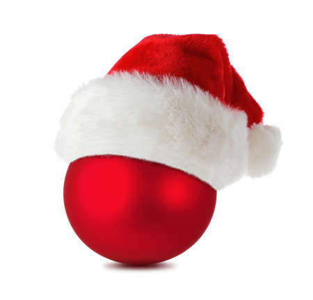 Red christmas ball wearing santas hat isolated on white  photo