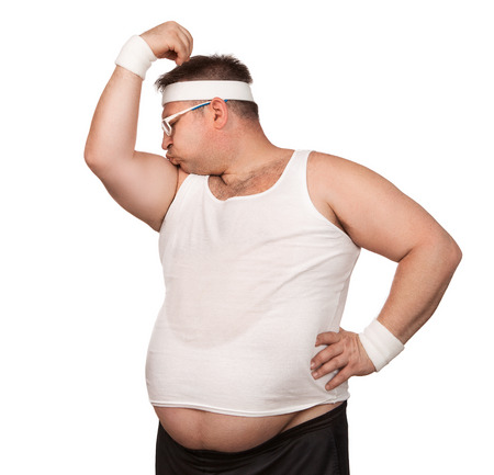 Funny overweight sport nerd kissing his bicep isolated on white background